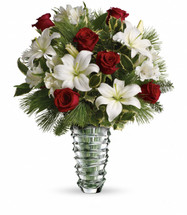 "Red roses and white asiatic lilies and alstroemeria are accented with tips of douglas fir, white pine, holly and assorted greens. Deliverd in a glass Beautiful vase. Approximately 18 1/2"" W x 22"" H"