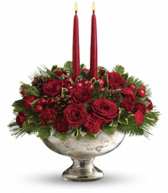 "Beautiful red roses, spray roses, carnations and berries are arranged with pine and fir branches, pinecones and holly. Two elegant taper candles complete this perfect arrangement. Approximately 16"" W x 16 1/2"" H"