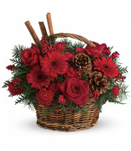 "Festive red roses, gerberas, carnations and berries are arranged to look their holiday best when mixed with cinnamon sticks and pinecones in a lovely wicker basket. It's a great way to get a handle on your holiday gift list! Approximately 14"" W x 13"" H"