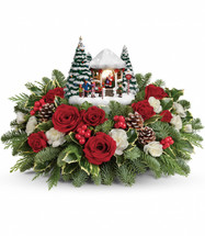 "This beautiful arrangement includes red roses, red spray roses, white miniature carnations, variegated holly, flat cedar and noble fir. Delivered with Thomas Kinkade's Jolly Santa keepsake. Approximately 16"" W x 10"" H"
