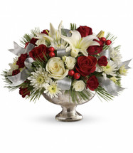 "This luxurious arrangement features deep red roses, snow white roses, beautiful white Asiatic lilies, and full white cushion spray chrysanthemums. Sprigs of white pine, red berries and silver mesh ribbon add an extra special holiday touch. Hand-delivered in a stunning mercury glass bowl they'll proudly display year after year. Approximately 15"" W x 11 1/4"" H"