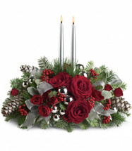 Bring elegance to your holiday table with this dazzling silver centerpiece. Silver ornaments, silver pinecones, silver ribbon - even silver candles. And, ah, the contrast of ravishingly red roses and evergreen. Your guests will be dazzled.