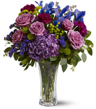 This eye-catching bouquet, with its cool-toned blend of lavender, chartreuse and blue blossoms, captures some of the magic and sophistication of one of the world's most exhilarating cities - New York! Send one today and share the excitement.
