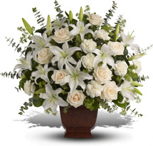 """Fresh flowers such as crème roses, white oriental lilies, carnations, eucalyptus and more are delivered in a lovely Noble Heritage urn. Approximately 27"""" W x 25"""" H"""