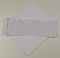 White Pique pre-pleated insert for smocking plus extra fabric for collars and cuffs. 8 rows pleated for 6 rows smocking suitable for outfits up to 12 months