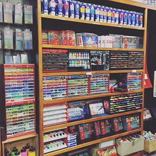 Inside Newtown Art Supplies Store - Shelves full of paints, tubes, drawing supplies