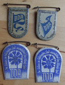 om067 - set of four VDA - Volksbund fuer das Deutschtum im Ausland - in conjunction with the WHW Winterhilfswerk 1933-34 season tinnies