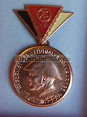 om924 - 7 - East German NVA  Reservist Medal in Bronze with Steel Helmet