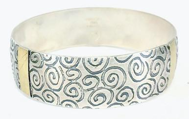 Sterling silver and 18tk gold bangle bracelet.