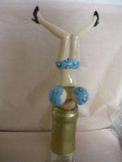 Wine Bottle Topper. Blue with spring action bosom.
