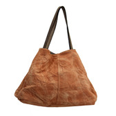 Reversible stonewashed rust shoulder tote.