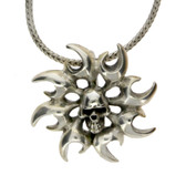 Skull sterling silver pendant with tribal design around skull.