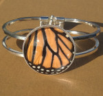 Handcrafted this amazing bracelet from a REAL Monarch Butterfly Wing embedded under magnified glass!  The bracelet is available in antique silver.  The glass measures 30x30mm.