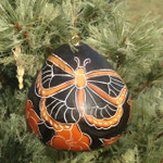 "Our Monarch butterfly ornament celebrates these amazing butterflies. Each gourd has been hand-carved and painted by a Peruvian artist. They average 2.5"" inches tall and details will vary as nature and the artist intended. Price is for one ornament."