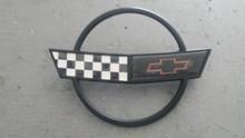 1991-1996; C4; Front Nose Bumper Emblem; USED