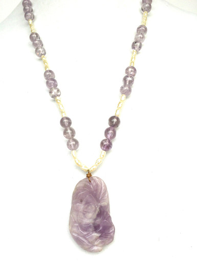 "#AN59  Exceptional Carved Amethyst Pendant Suspended from a Lovely Simple Strand of Lovely Amethyst Beads and Pearls  Price $155.     24"" long"