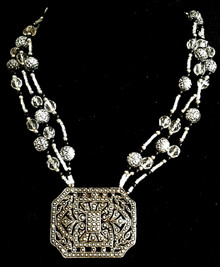 "Vintage Etched Silver Pendant on Multi Strands of  Vintage etched beads with crystal and onyx  18"" long $158."