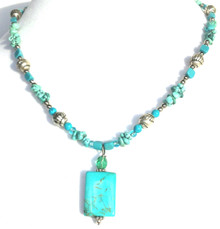 #Bn46  One-of-a-kind Delicate Small Rectangular Semi-PreciousTurquoise Pendant hanging from a strand of Etched Silver and Turquoise chips handmade by jewelry artist Lois Becker  Price $75. length 18""