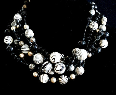"#AN34 Make an Impression wearing this  ChunkyChoker  that will Fill in Any Neckline. Chunky and  Hand Made Using Dramatic Black and White Marbelized Beads of all Sizes,  Shining Black and Silver Beads it makes a Fashion Statement. Price $158. Length 17"" or 18"" but can be custom made to fit your specifications for an extra charge."
