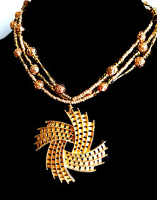"""#BN74 Hand crafted Important Looking Vintage Gold Pendant on Multi Strands of Gold beads. Hand Made by Jewelry artist Lois Becker you won't see this anywhere else. Price $165. Length available in 18"""" or 20""""  May be ordered in a custom size to fit your needs for an extra charge"""