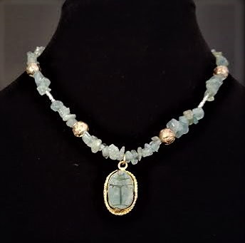 "#BN62 A Unique Necklace featuring a Delicate Carved Scarab Pendant from Egypt hanging from a lovely feminine strand of Aquamarine and engraved gold rosebud beads separated by tiny crystal beads.  Price $5.  length 16"" Available in custom size to fit your needs for a slight extra charge"