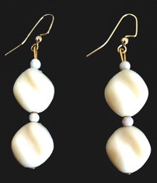 A Double Twisted Winter White Earring with Fossil Stone Accent .  $25. avialable in wire, post or clip on