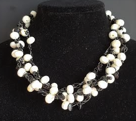 """Hand Crocheted Choker with Multiple Strands of  Lightweight Shinny White Lacquer beads and Black Accents Price: $125. Length 18"""" but may be custom sized to yor preference for a slight additional charge"""