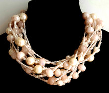 "#BN93 Handmade necklace made with Multiple strands of large cream colored pearls, Blush Pink Lacquer Beads and tiny pink crystals .  This Lightweight but Bulky Choker makes a Fashion Statement and will fill in any neckline with grace Price:$135. Length 18"" may be special ordered in preferred size for additional charge"