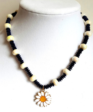 "#CN11  Daisy Pendant on a lovely handmade strand of gleaming white lightweight lacquer beads with interesting NAVY BLUE accent beads  $48. 18"" long May be custom sized for an additional charge"