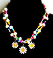 #CN9 Fun and Colorful Handmade Three Daisy Necklace with double strands of gleaming white lacquer beads and multi colored accents Price:$75. 18 inches long  May be custom ordered in another size for an additional charge. Earrings to match available by request for $25. in wire, post or clip on