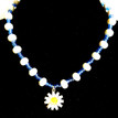 #CN4  Necklace Daisy Pendant suspended from a single handmade strand of shinny white lacquer beads with vibrant blue accents 18 in. long $45.