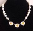 "#CN5  Three Daisies on a handmade strand of Beautiful Pearlized White Lacquer Beads, with shinny faceted beads in between to add a bit of glamor. Lightweight and lovely.  18"" long Price $48."