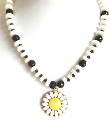 #CN7  Daisy Pendant hung from a handmade stunning Chalk White and Shiny Faceted Black Beads, lightweight and Fashion Forward $48. Drop Earrings to match by special order $25. available in wire, post or clip on