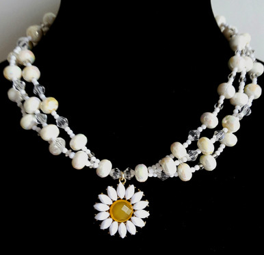 """#CN6  Daisy Pendant surrounded by three handmade strands of High sheen white Lacquer  and crystal accent beads. 18"""" long Price $75."""