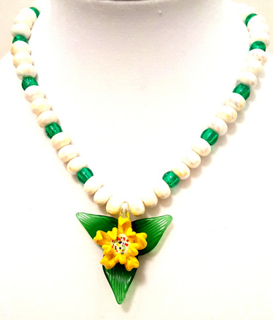 "#CN3 Hand Blown Glass Flower, Three Dimensional Yellow and White Flower Pendant on a Green Leaf Background suspended from a strand of Pearlized White Lacquer Beads and Translucent Green Beads 18"" $48."