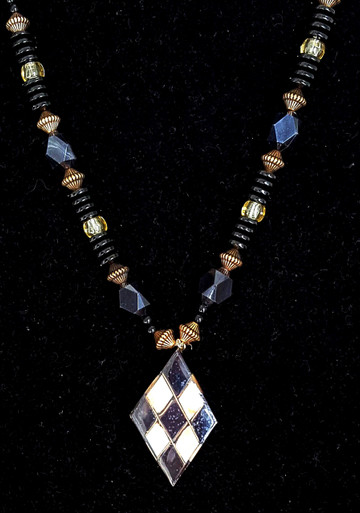 "#CN20 Unusual Pendant with Geometric Design of Inlaid Abalone and Black Shell for the woman who likes the unique 24 "" long $65."