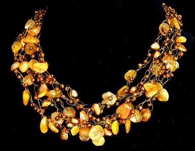 #CN21  Jewelry Artist Lois Becker made this One-of-a-kind Hand Crochet Necklace on Multiple Strands of Golden Agates with Copper Colored Accents for the Woman who loves Wonderful Fashion Accessories. 18 in long $165. May be custom ordered in preferred size for additional charge.