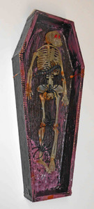 Skeleton in a coffin by George Borum