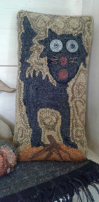Punch hooked pillow.by Angela Jones.  The cat was punched with torn wool strips using a size 9 regular Oxford punch needle and the rest of the pillow was punched with hand dyed rug yarn using a size 10 regular Oxford needle.