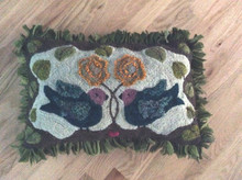 Hooked by Barbara Lane,  Michigan.  Barbara made this pillow as a wedding gift for her friends.