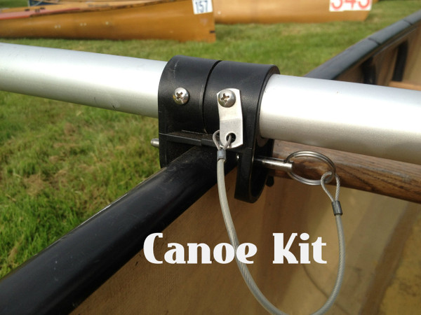 """Canoe Mount. 2 Canoe brackets are slid over cross tube and set with screws. A 1/4"""" fast pins is used to mount the cross tube to the hull. A mast foot is glued to the bottom of canoe."""