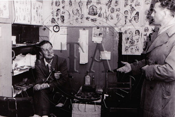Black & White card showing this Amsterdam tattooist in his shop, c 1950s. 4 x 6