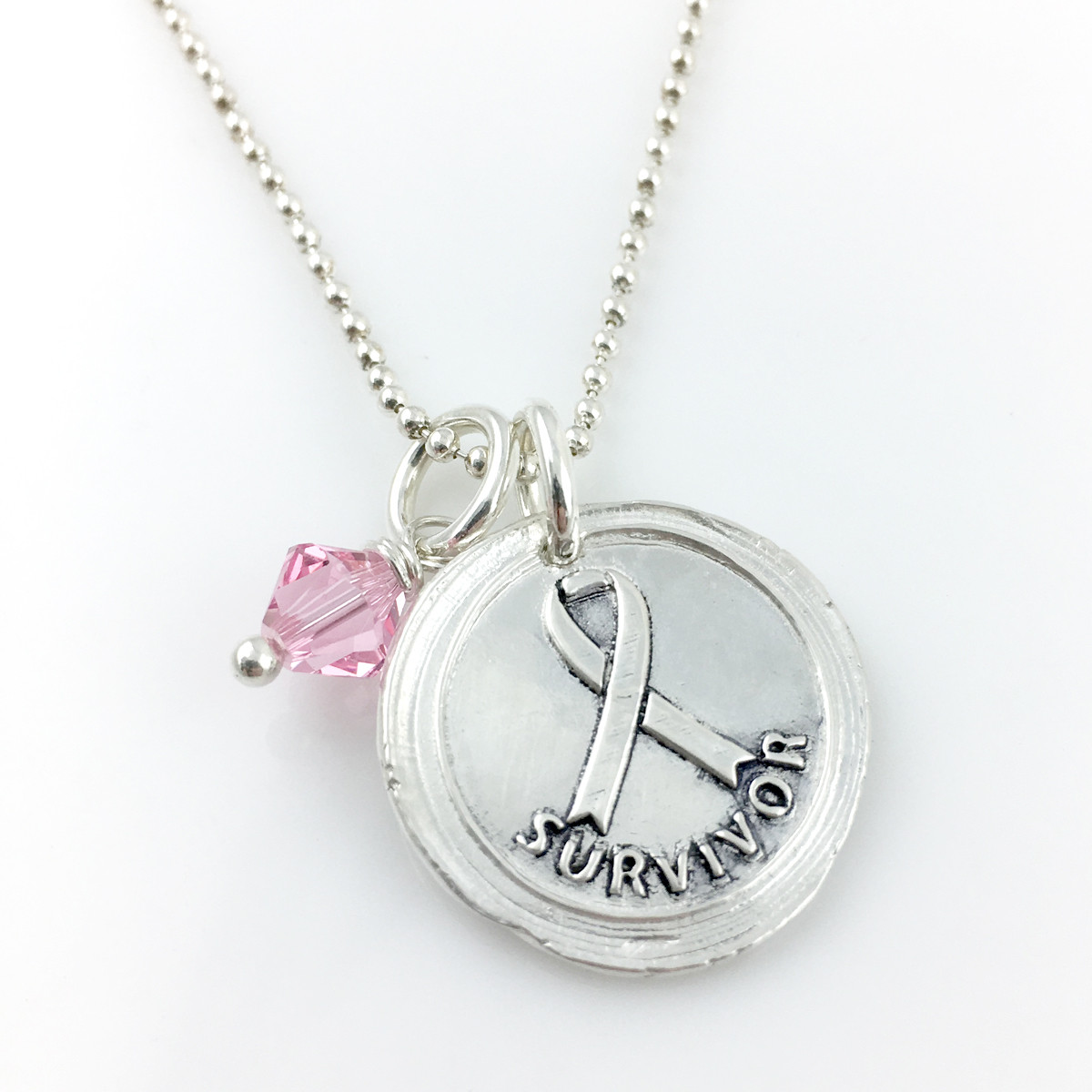 Breast Cancer Survivor | Awareness Ribbon Wax Seal Necklace shown with added pink crystal