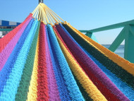 The vibrant colors of a rainbow Costa Rican soft sided hammock!
