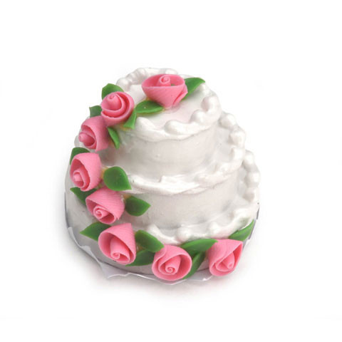 Three-tier white cake with pink roses and green leaves