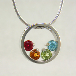 If you are looking for an elegant, classy birthstone pendant, you found it! Available for up to 6 gemstones, in 14 karat Yellow or White Gold, and it comes with a 1mm 16 inch snake chain. We use only genuine and lab created birthstones. Unless otherwise requested, stones will always be centered at the bottom of the circle. If you would like different stone options, such as genuine Emerald, Ruby, or Sapphire, please call or email us. We can make this any way you'd like, and in most metals.  Please let us know how you would like yours, if different from the options listed here. This is a Special Order item (see Policy information for details), and ships in approximately 2 weeks.  Designed, and created in our studio by the artist Stuart J.