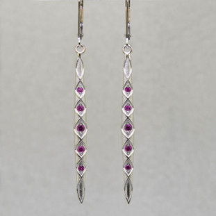 You will feel like a Princess wearing these striking, long dangling Pink Sapphire earrings. Set with very fine diamond cut Pink Sapphires weighing .30ct. T.W., set in 14 karat Brilliant White Gold dangling from lever backs. Earrings measure 2 1/4 inches long.  Designed, and created in our studio by the artist Stuart J.