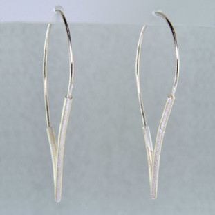 "Try this modern touch on a hoop earring. Still feels like a hoop, but the fun shape makes it unique. Crafted in Sterling Silver, with a sensual pear shape. Earrings measure 1 3/4 inches long and 1"" wide.  Handmade in Istanbul, Turkey."