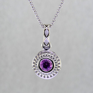 Blending traditional and modern, this pendant dazzles, day or night. Handcrafted in 14 karat White Gold, with a vibrant .40ct. round Pink Sapphire. This beautiful pendant comes with a 14 karat White Gold cable chain, 18 inches long. Pendant measures 5/8 inch long.  Designed, and created in our studio by the artist Stuart J.