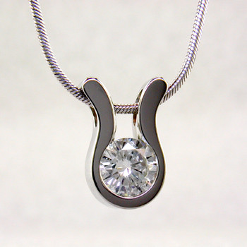 An elegant, modern shape makes this pendant a go-to for every occasion. 14 karat White Gold with a .22ct. (G SI2 Quality) Ideal cut Diamond, this pendant has a classic, timeless style. Includes a 14 karat White Gold 1mm cable chain, 18 inches long. Pendant measures 1/4 inch long.    Designed, and created in our studio by the artist Stuart J.